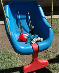 A doll on a swing in the young mother's home run by Casa Alianza