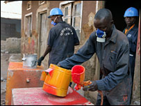 Workers at a stove factory in Uganda