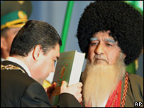 Berdymukhamedov kisses a copy of ' Rukhnama', written by the late President Saparmurat Niyazoy at his inauguration