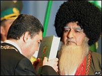 Berdymukhamedov kisses a copy of ' Rukhnama', written by the late President Saparmurat Niyazoy at his inauguration