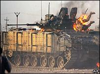 British soldier on burning tank
