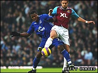 Yakubu and Matthew Upson (right)