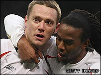 Bolton skipper Kevin Nolan (left) is congratulated by team-mate Ricardo Gardner after his goal at Manchester City