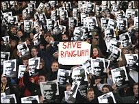 Watford fans hold posters of Al Bangura