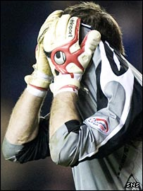Hearts goalkeeper Eduardas Kurskis hides his head in shame