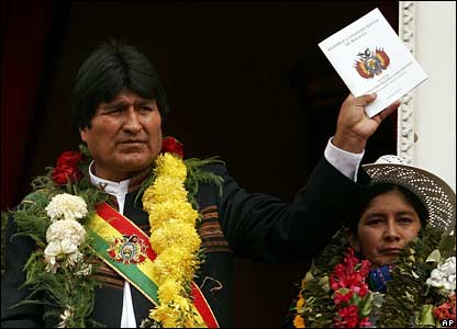 Evo Morales with the new constitution