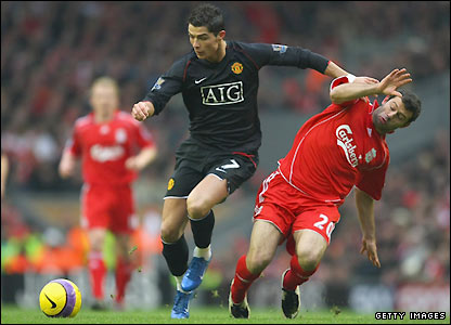 Javier Mascherano attempts to tackle Ronaldo