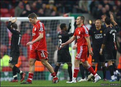 Liverpool's players leave the pitch as Man Utd celebrate