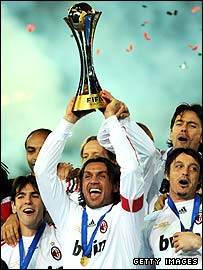 Paolo Maldini holds the Club World Cup trophy aloft before announcing he will retire at the end of the season