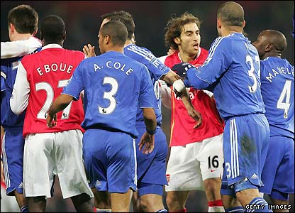 The players brawl at the Emirates