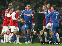 Arsenal and Chelsea players clash at the Emirates Stadium