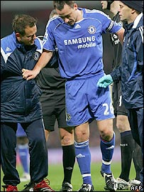 Chelsea captain and centre-back John Terry limps off during the game at Arsenal