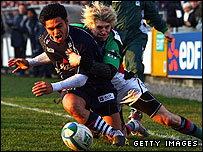 David Lemi is tackled by David Strettle of Harlequins