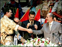 Major General Graham Binns, left, shakes hands with Iraqi National Security Advisor Dr Mowaffak Baqer al-Rubaie