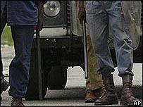 Zimbabwean police holding truncheons