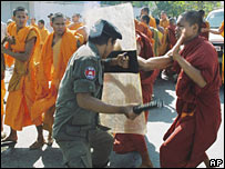 Cambodian anti-riot police officers chase Buddhist monks in front of Vietnam Embassy in Phnom Penh, Cambodia (17/12/2007)
