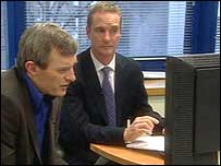 Jeremy Vine with Det Sgt Nick Duffield in front of a computer