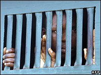 A Nigerian prisoner transported from court in a police van