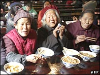 Elderly Buddhists eat in meal in the dining hall of a temple in Chengdu, China (10/12/2007)