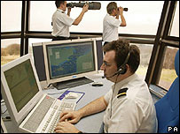 Coastguards in an operations room