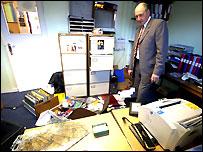 Principal John Platt surveys the damage