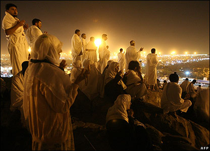 Muslims on the Hajj pray at Mount Arafat