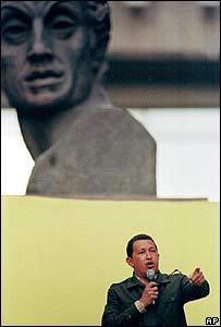 Hugo Chavez delivers a speech in front of a giant bust of Simon Bolivar in Caracas (image from July 1999)