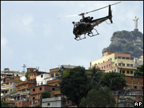 A police helicopter flies over a shantytown in Rio de Janeiro (file photo)