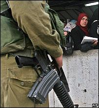 Israel soldier at a checkpoint for Palestinians in the West Bank
