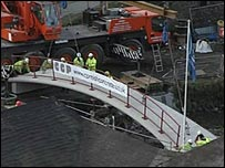 The new bridge is lowered into place