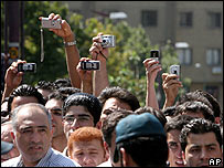 Iranians take pictures of a double public hanging in Tehran, 2 August 2007
