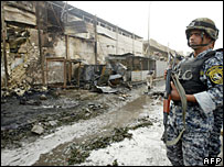 An Iraqi soldier at the site of a car bomb in Baghdad, 18 December 2007