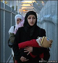 Palestinian women cross Bethlehem checkpoint