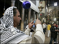 Foreign tourist in Palestinian headdress at Church of the Nativity