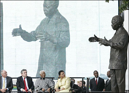 Nelson Mandela looks on as his statue is unveiled at Parliament Square