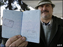 A Hungarian shows stamps in his passport