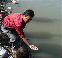 Man holding dead Brahmaputra fish