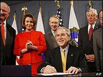 President Bush signs the Energy Independence and Security Act surrounded by Congressional leaders