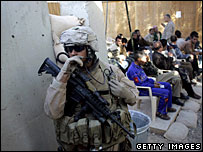 A US Marine stands guard as local residents wait to have a Falluja resident badge issued (File picture)