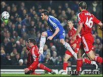 Frank Lampard shoots and sees his shot take a deflection on its way into the Liverpool net