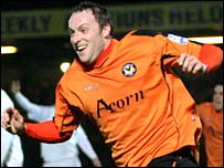 Newport County striker Charlie Griffin celebrates his winner against Swansea
