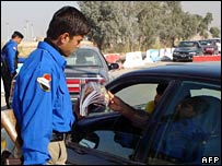 Falluja police hand out leaflets to motorists, 28 November 2007