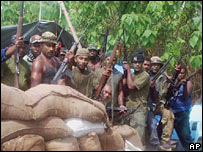 Heavily armed rebels in a jungle camp near Honiara, Solomon Islands (June 2000)