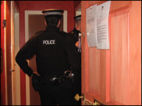 Police officers at the home