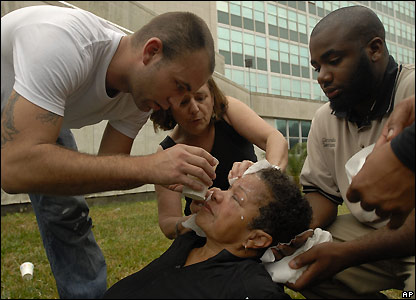 Woman is treated for pepper spray after police blocked dozens of protesters from entering the New Orleans City Hall - 20 December 2007
