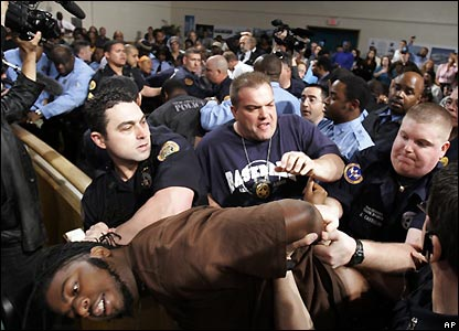 Several protesters were removed from the council chamber after scuffles broke out - 20 December 2007