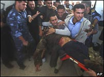 Palestinians mourn a dead Hamas militant in a southern Gaza Strip morgue on 20 December 2007