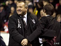 Dons manager Jimmy Calderwood celebrates at the final whistle