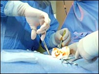 Surgeons perform an operation at a hospital