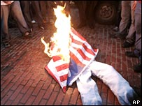 An effigy and a US flag are burned in protest to mark 18th anniversary of the US invasion of Panama in Panama City Thursday 20 December 2007